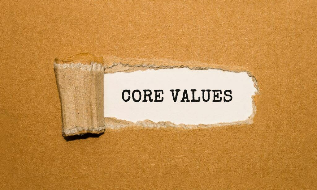 text core values appearing torn brown paper